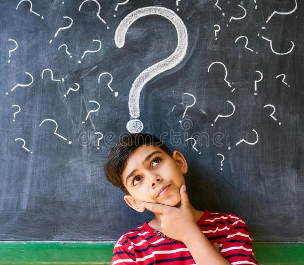 doubts question marks child thinking school concepts blackboard hispanic boy thoughts class portrait male 84546977